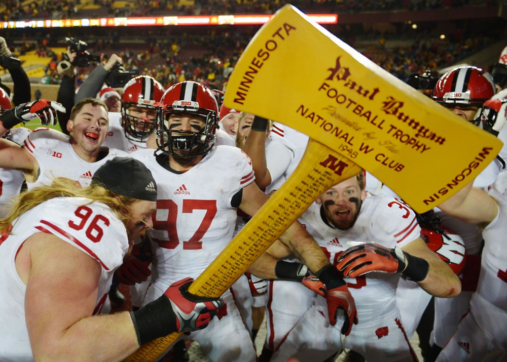 Wisconsin lineman Beau Allen swings Paul Bunyun's Axe after the Badgers defeat Minnesota 20-7 at their last home game of the season.