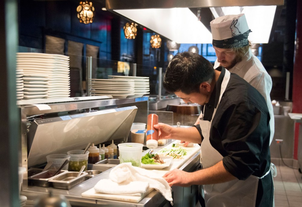 Misrael Becerril and Eric Halverson prepare food at the Rabbit Hole on Tuesday afternoon before the restaurant opens for dinner. The Rabbit Hole, featuring Korean street food, just opened in the Midtown Global Market after reaching its goal on Kickstarter.