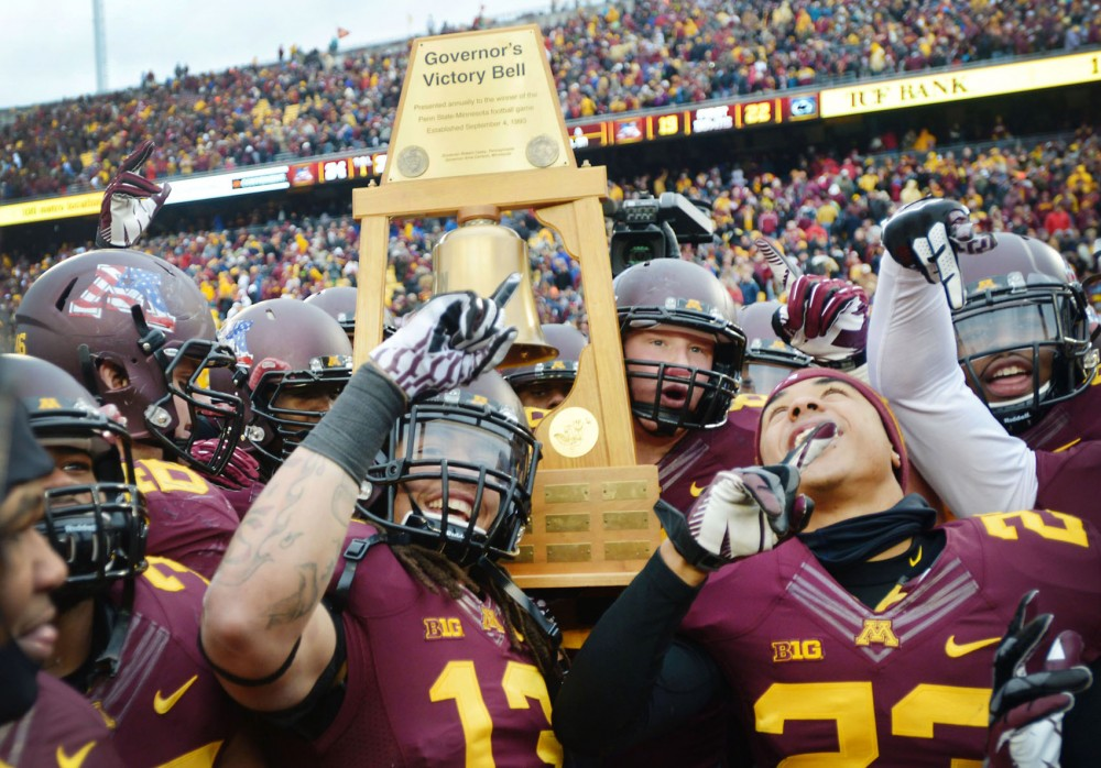 Gophers players celebrate after beating Penn State 24-10 on Saturday at TCF Bank Stadium. It was the fourth straight Big Ten win for Minnesota.