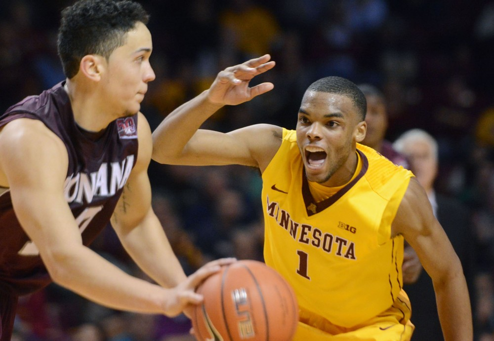 Minnesota guard Andre Hollins defends against Montana on Tuesday, Nov. 12, 2013, at Williams Arena.