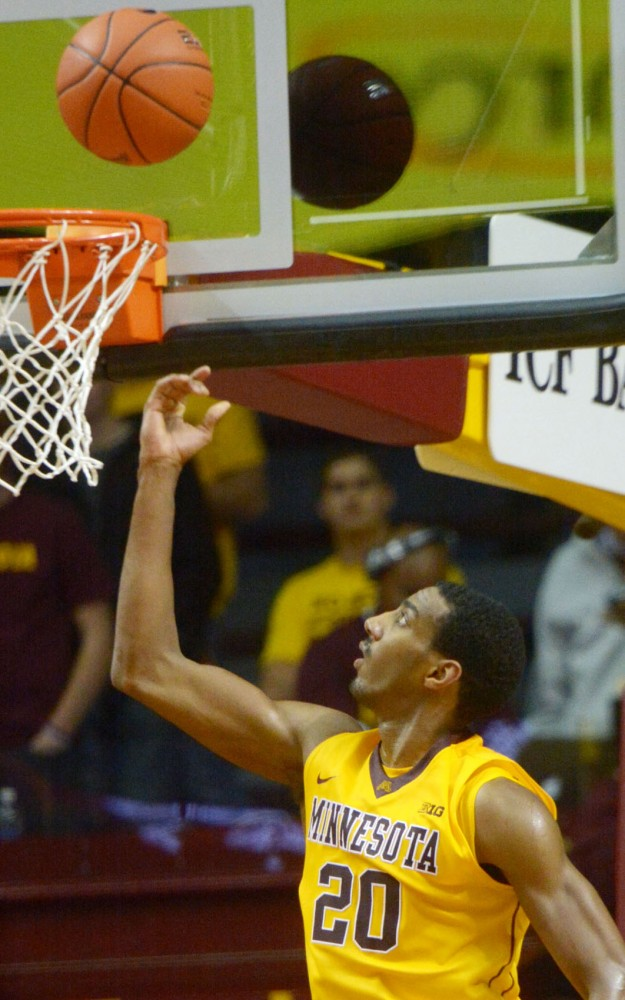 Senior guard Austin Hollins scores a two point shot against Wofford on Thursday, Nov. 21, 2013, at Williams Arena.