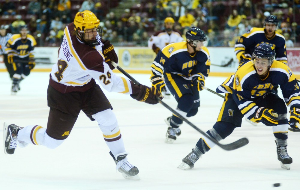 Minnesota forward Hudson Fasching shoots the puck against Lethbridge on Saturday, Oct. 5, 2013, at Mariucci Arena.