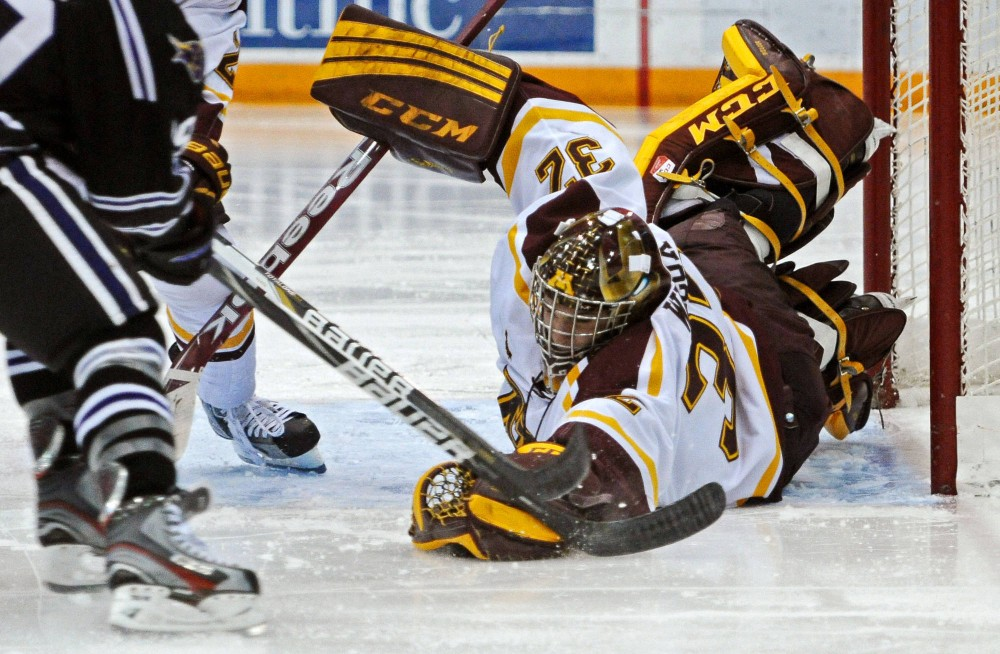 Minnesota goalie Adam Wilcox grabs the puck during a game against Minnesota State-Mankato on Friday, Nov. 2, 2012, at Mariucci Arena.