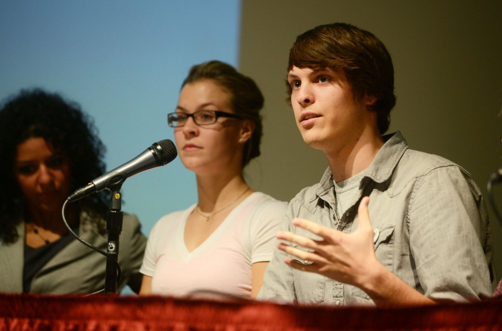 University student Alec Fischer discusses ways to support someone who might be going through a mental health crisis at a discussion panel at Coffman Union on Wednesday.
