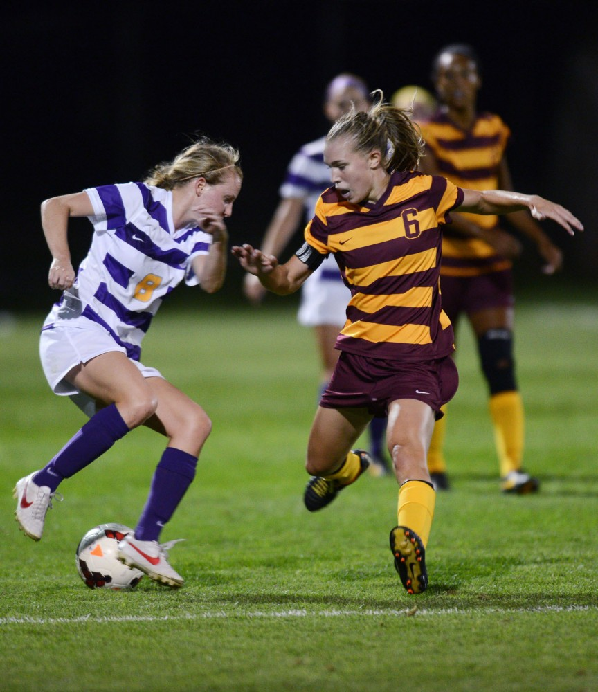 Minnesota midfielder Katie Thyken fights for the ball against Louisiana State on Sept. 6, 2013.