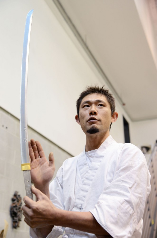 Fusataro holds a sword Friday that he created at the Regis Center for Art. Fusataro, a 25th-generation Kanefusa Japanese swordsmith, will give a presentation Thursday to students interested in swordsmithing.