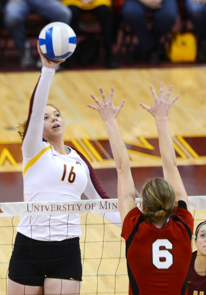 Minnesota middle blocker Adrianna Nora spikes the ball against Nebraska at the Sports Pavilion on Sunday.