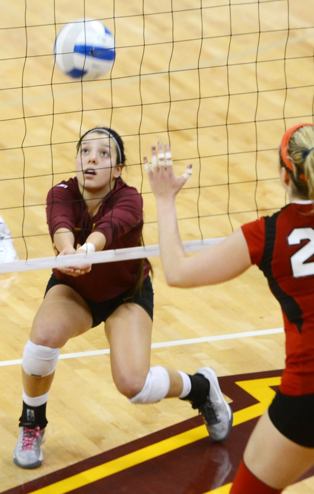 Minnesota defense specialist Lindsey Lawmaster sets the ball against Nebraska at the Sports Pavilion on Sunday.