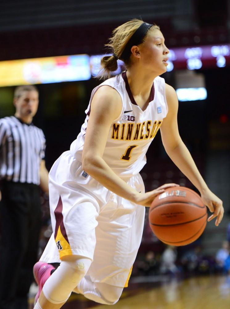 Minnesota guard Rachel Banham dribbles toward the basket on Sunday, Feb. 24, 2013, at Williams Arena.