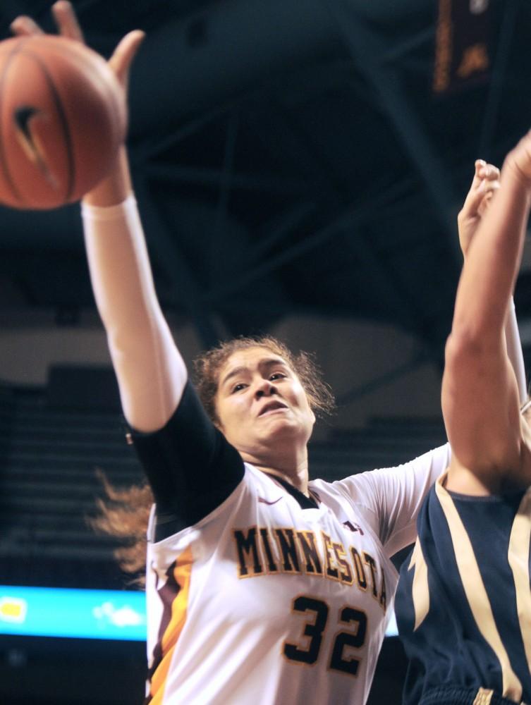 Minnesota center Amanda Zahui B. regains control of the ball against Navy on Sunday at Williams Arena.