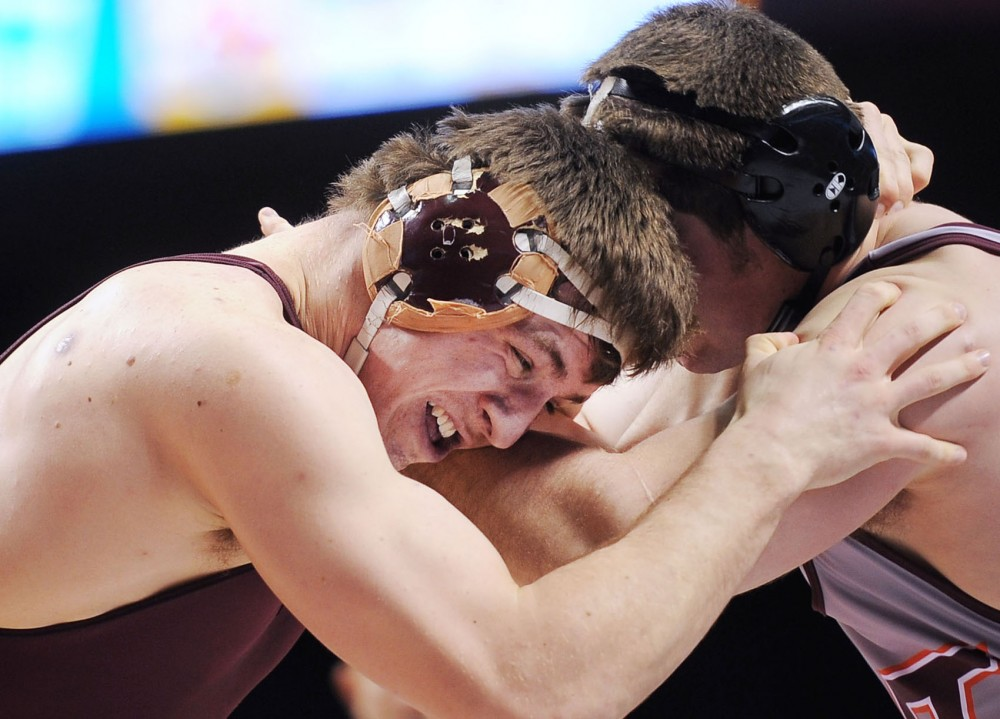 Minnesota heavyweight Tony Nelson grapples with Virginia Tech's David Marone on Friday, Feb. 22, 2013, at Williams Arena.