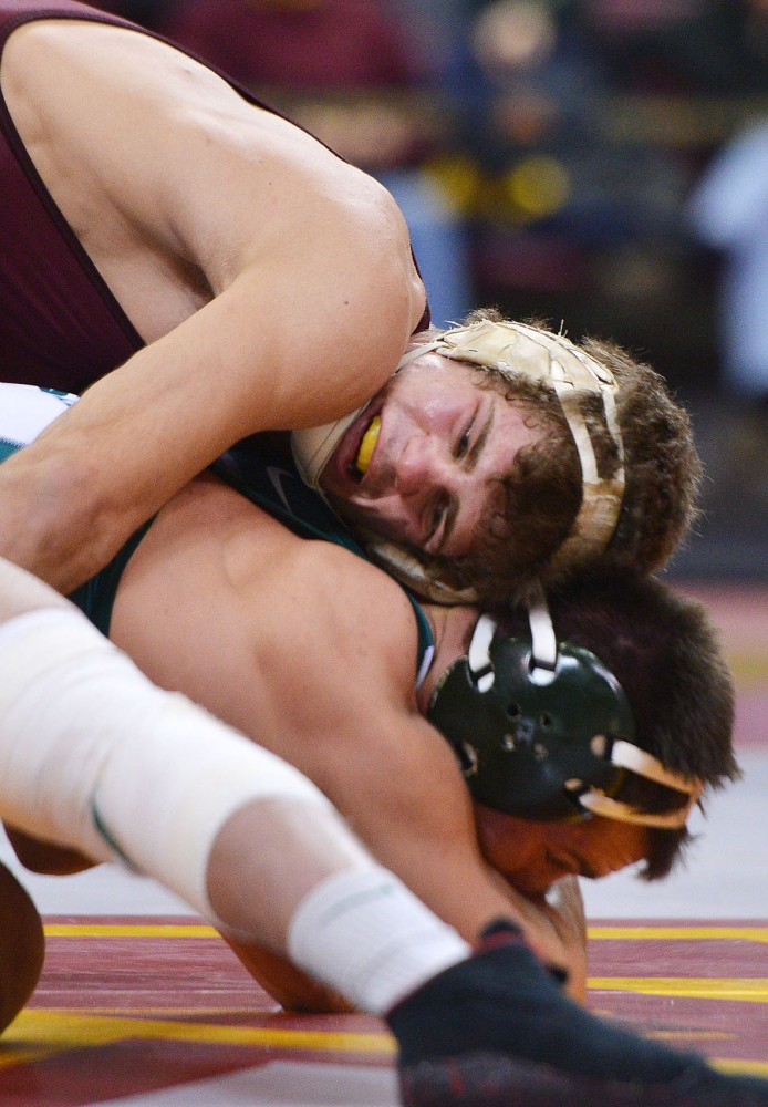 Minnesota's Dylan Ness tries to take down Michigan State's Dan Osterman on Sunday, Feb. 3, 2013, at the Sports Pavilion.