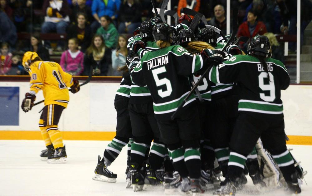 University of North Dakota women's hockey players celebrate after snapping the University of Minnesota women's hockey team's 62-game winning streak.