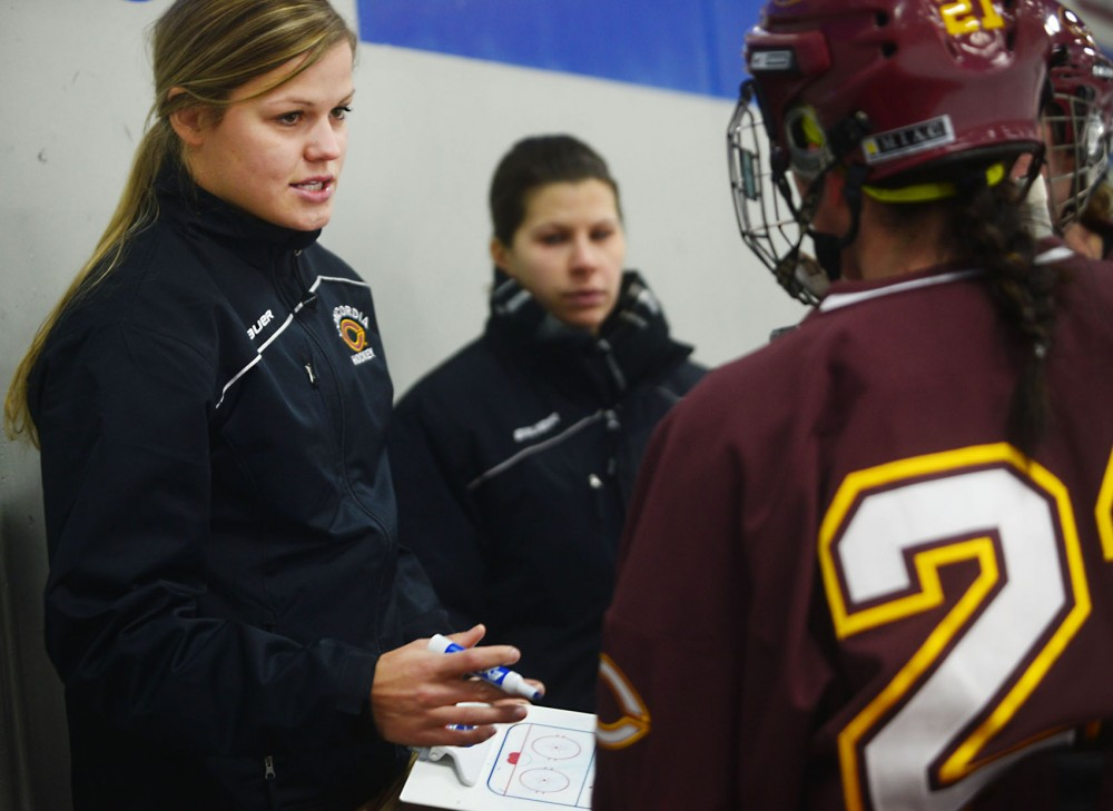Former Gophers women's hockey forward Sarah Erickson coaches her team, the Concordia Cobbers, in a game at St. Thomas on Saturday.