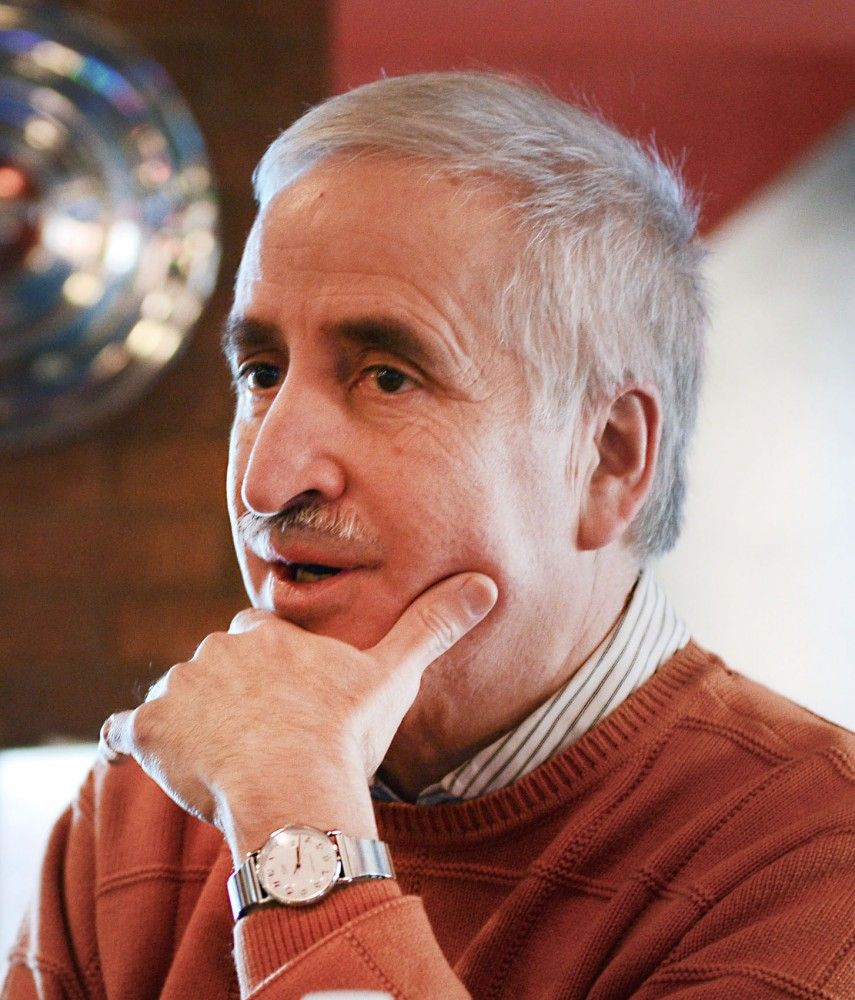 Owner of Autographics Skott Johnson attends the Dinkytown Small Area Plan meeting at Burrito Loco on Thursday. Johnson, is stepping down as DBA president this year.