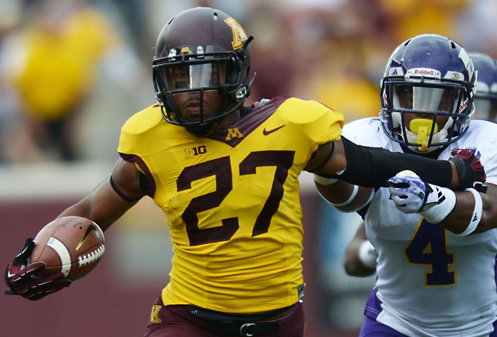 Minnesota running back David Cobb protects the ball from Western Illinois on Saturday, Sept. 14, 2013, at TCF Bank Stadium.