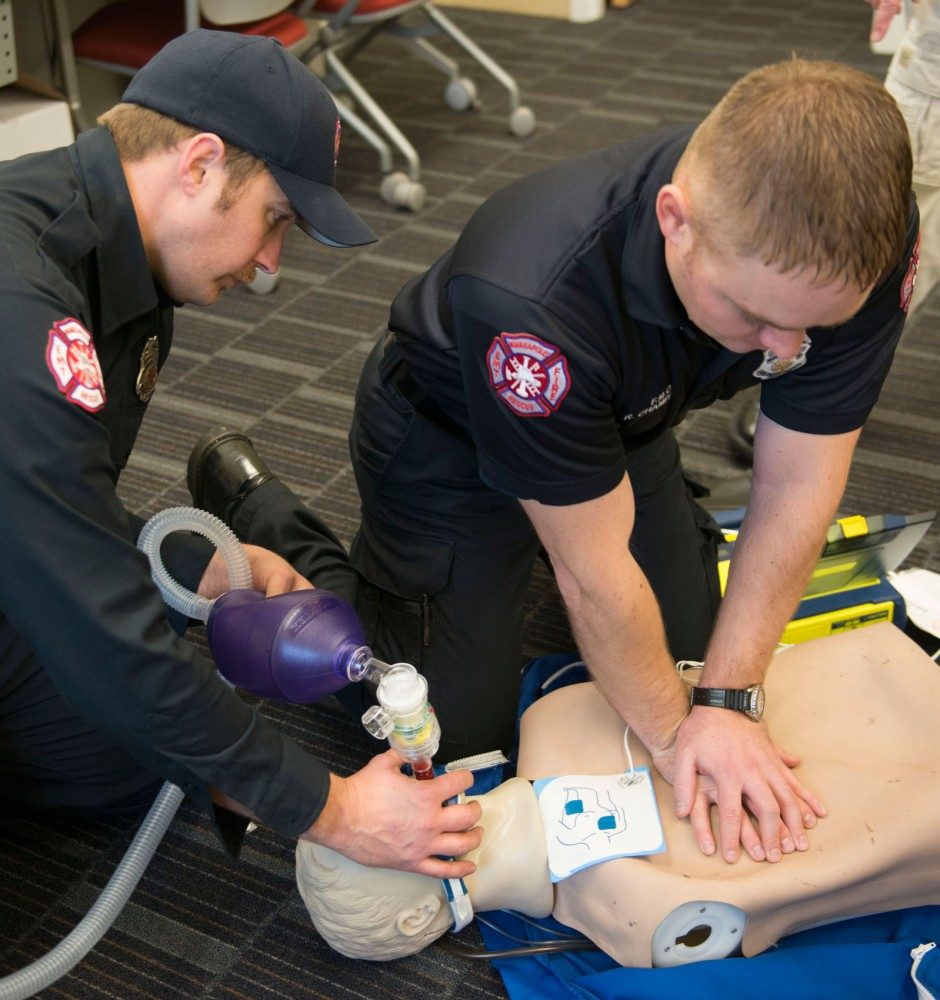 Firefighter Emergency Medical Technicians Brock Tuntland and Riley Champagne practice high performance CPR at the Emergency Operations Training Facility on Tuesday.  EMT training uses funds from the Minnesota Board of Firefighter Training and Education training grant.