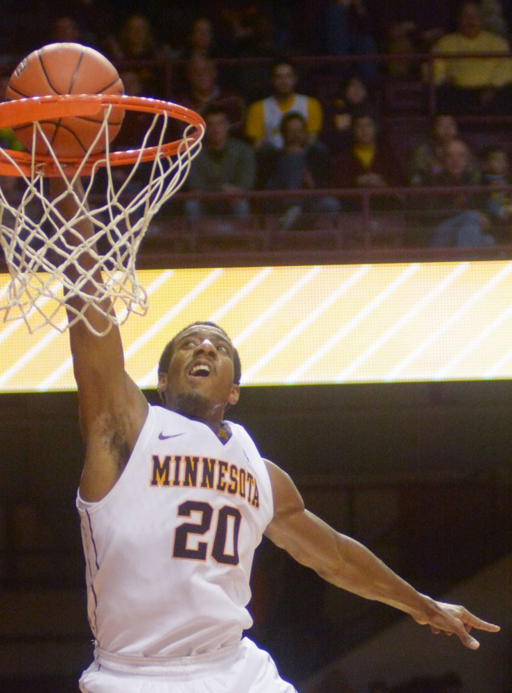 Minnesota guard Austin Hollins dunks the ball against New Orleans on Saturday at Williams Arena.