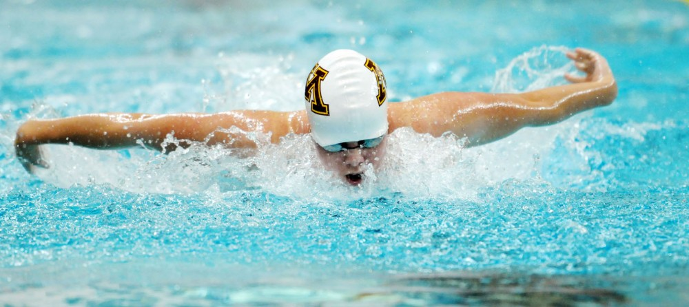 Kierra Smith swims the 100-yard butterfly against Iowa State on Friday, Oct. 12, 2012,  at the University Aquatic Center.
