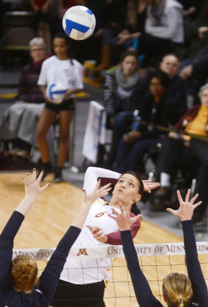 Gophers middle blocker Tori Dixon prepares to spike the ball against Penn State on Saturday, Nov. 16, 2013, at the Sports Pavilion.
