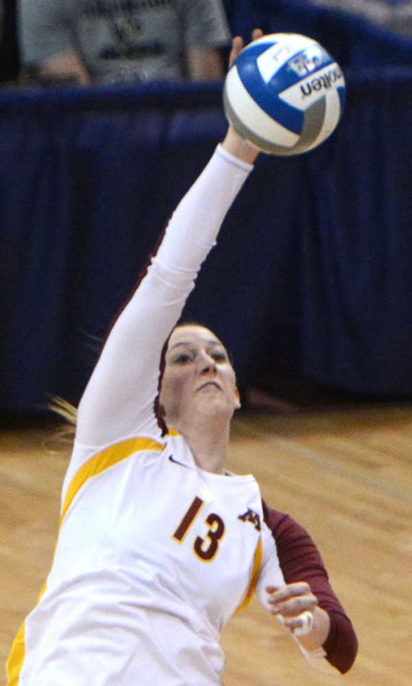 Minnesota outside hitter Ashley Wittman spikes the ball against Radford at the Sports Pavilion on Friday. The Gophers advanced to the Sweet 16 with wins on Friday and Saturday.