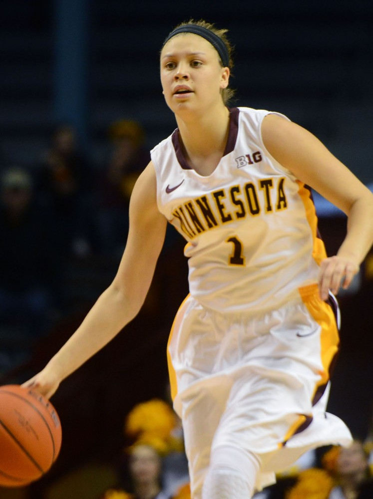 Junior guard Rachel Banham sets up a play against Loyola at Williams Arena on Tuesday, Nov. 26, 2013.
