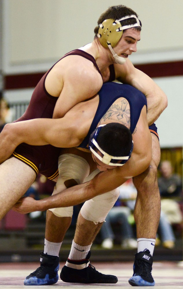Minnesota's Scott Schiller takes down Illinois' Mario Gonzalez on Jan. 21, 2013, at the Sports Pavilion.