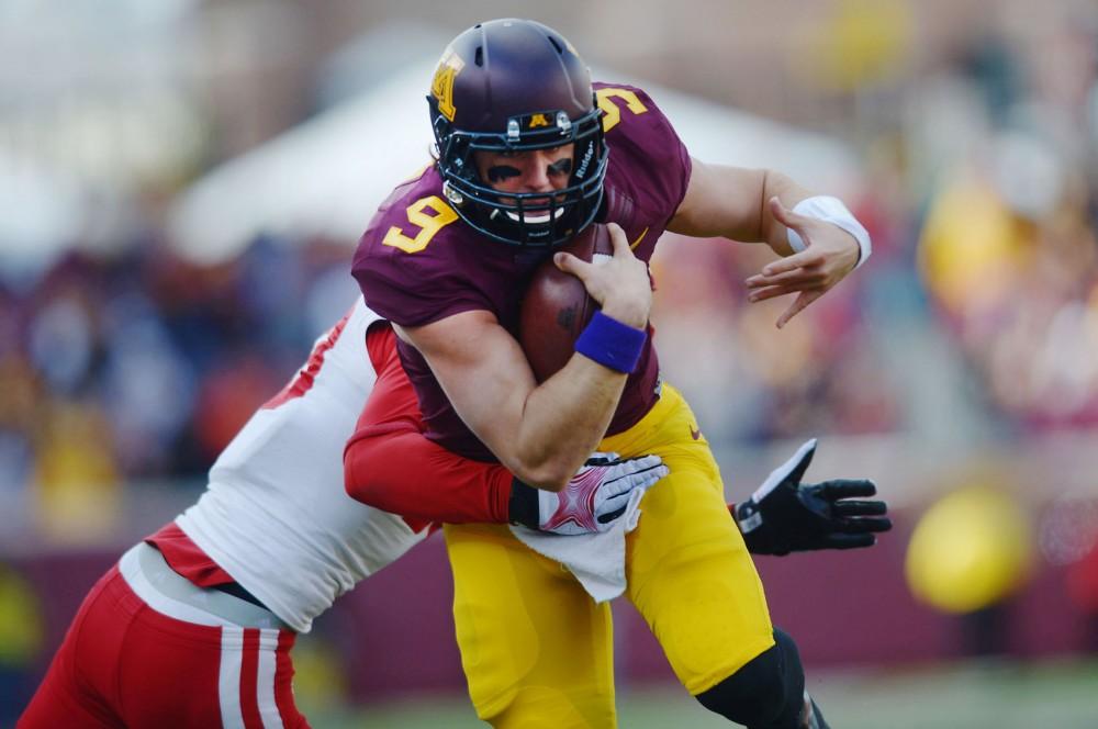 Minnesota quarterback Philip Nelson avoids a tackle on Saturday Oct. 26 versus Nebraska at TCF Bank Stadium.