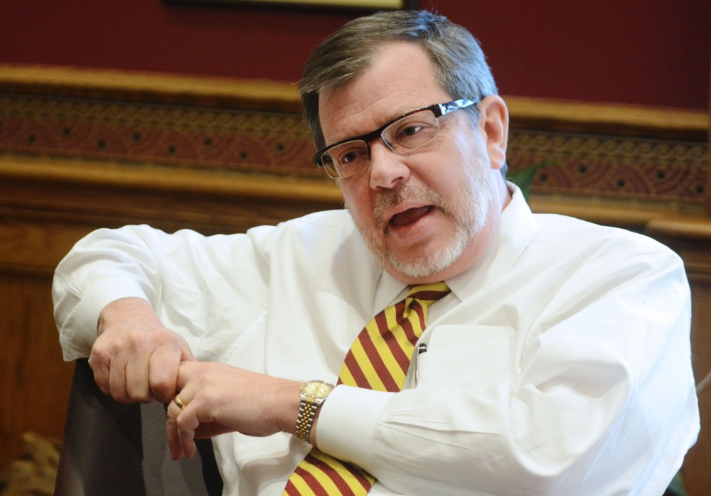 University President Eric Kaler discusses campus issues, including the tobacco-free policy and the CBS-CFANS merger, at his Morrill Hall office Tuesday.