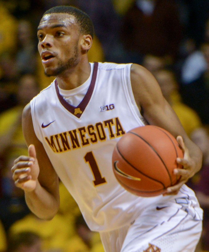 Minnesota guard Andre Hollins plays against South Dakota State at Williams Arena Tuesday Dec. 10th.