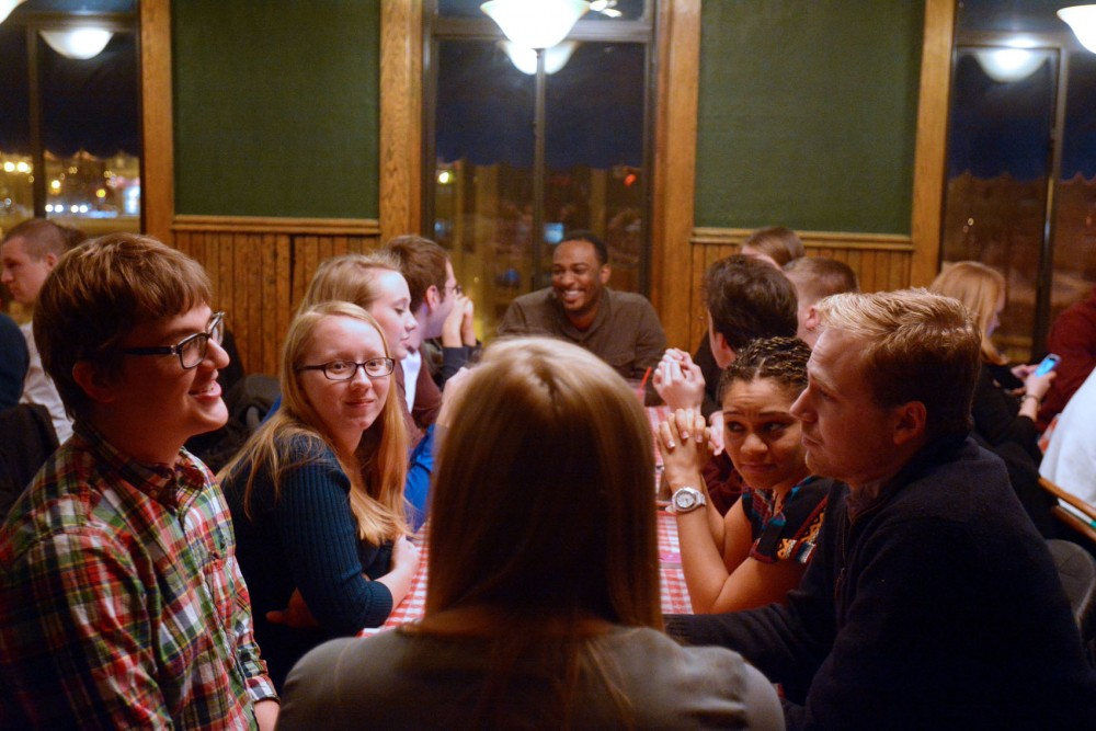 Senior Rylee Ahnen, left, talks with other ABTS members at Annie's Parlour Saturday evening.