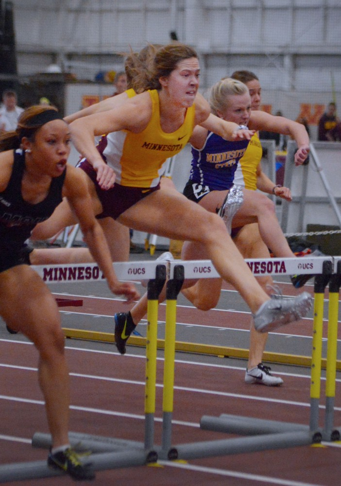 Sophomore Alex Beckman flies over the last hurdle in the woman's 60 meter hurdles final, coming in second place Saturday at the Field House.