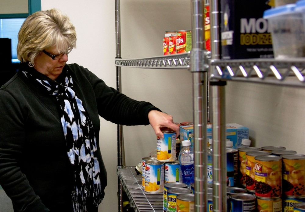 University of Minnesota Extension employee Ann Luke looks over the Ramsey County location's stock of food, Friday evening afternoon at the Ramsey County extension office. Luke and other employees transition are adapting to the new Supplemental Nutrition Assistance Program.