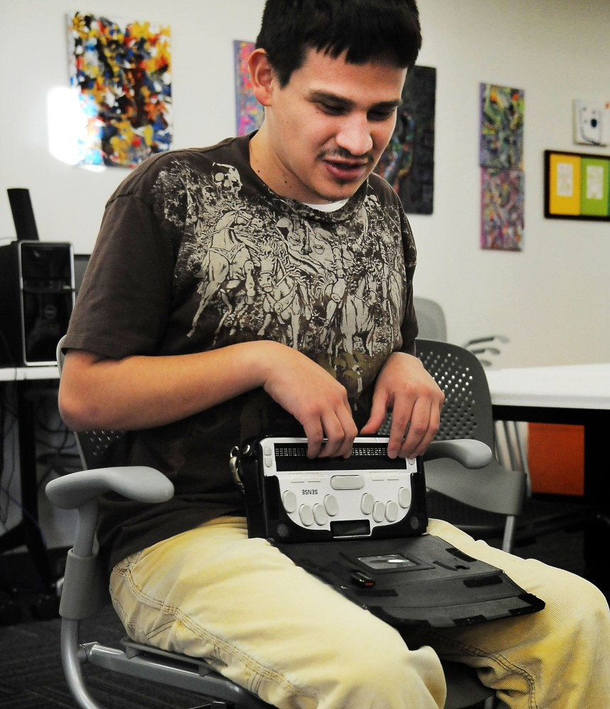 Junior Jacob Vasquez demonstrates how he reads notes on his Braille note-taker on Tuesday, Nov. 19, 2013.