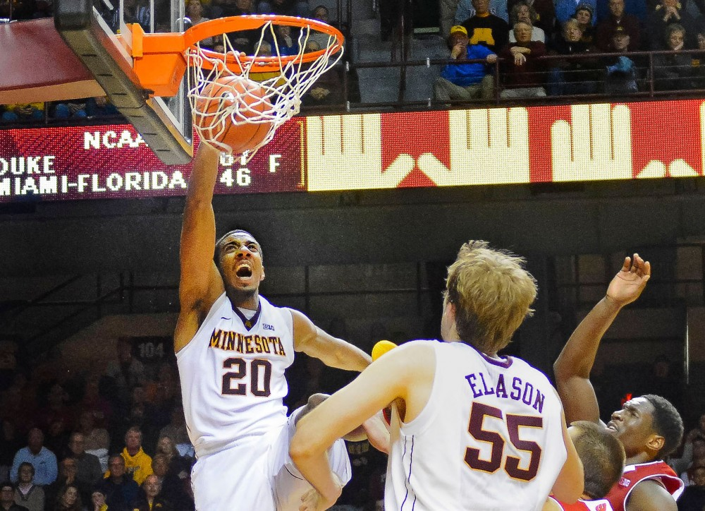 Minnesota guard Austin Hollins slams home a dunk against the Badgers in the second half of Wednesday night's game at Williams Arena. The Gophers upset No. 9 Wisconsin 81-68.