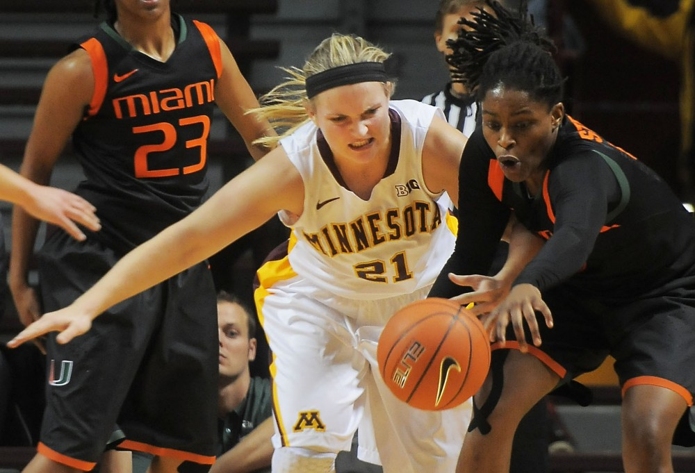 Minnesota guard Sari Noga fights for control of the ball in the game against Miami on Monday, Oct. 7, 2013, at Williams Arena.