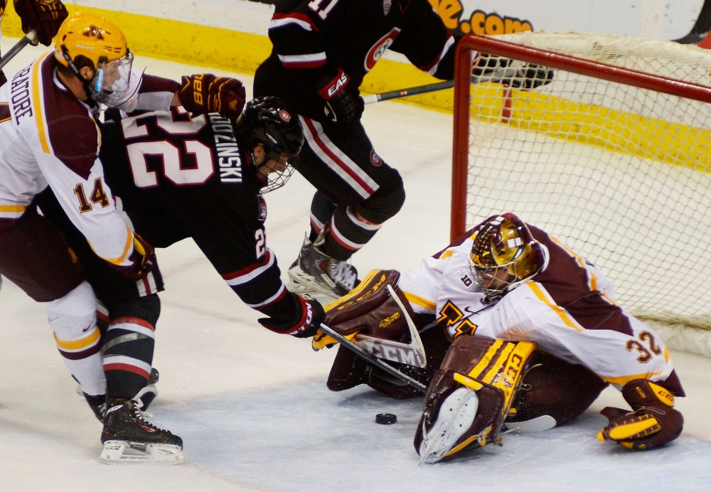 Minneota goalie Adam Wilcox attempts to block an incoming puck during their first game of the North Star College Cup against St. Cloud State on Friday night at the Xcel Energy Center in St. Paul.