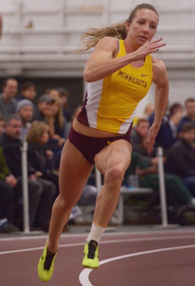 Senior Megan Geyen comes around the first curve in the women's 200 meter dash on Friday in the Field House. Geyen came in 5th place out of 57
