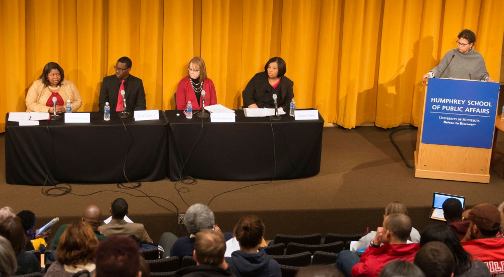 At the Campus Crime and Public Safety Forum, attendees and panelists discuss public safety and the potential for racial profiling on Wednesday night at the Humphrey School of Public Affairs.