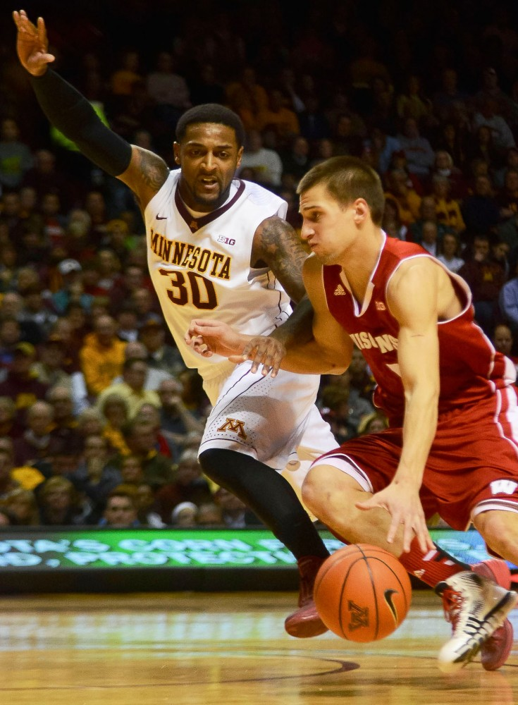 Minnesota guard Malik Smith defends against Wisconsin's Ben Brust on Wednesday, Jan. 22, 2014 at Williams Arena.