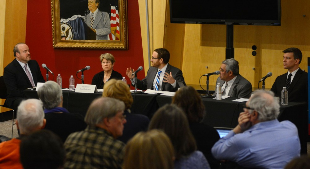 Minnesota Chamber of Commerce Manager of Energy & Labor/Management Policy Ben Gerber, center, speaks at a panel discussion,