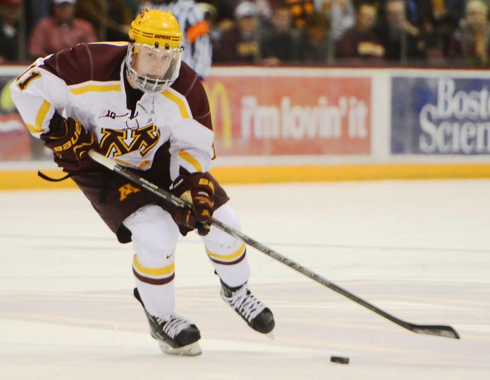 Gophers forward Sam Warning skates against Wisconsin on Saturday, Nov. 30, 2013 at Mariucci Arena.