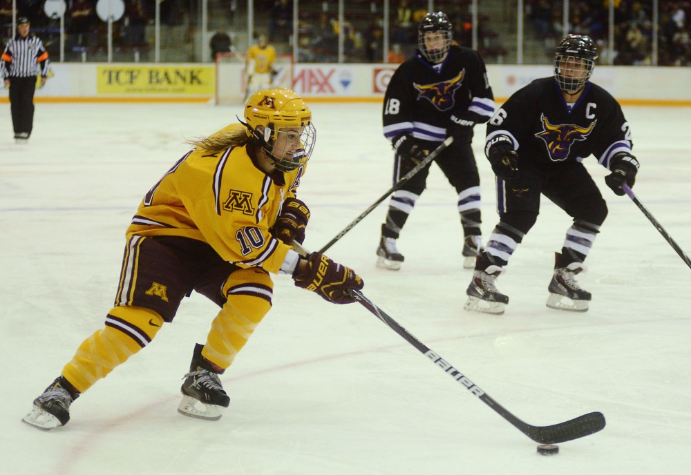 Minnesota forward Kelly Terry controls the puck against Minnesota State-Mankato on Friday, Nov. 1, 2013 at Ridder Arena.