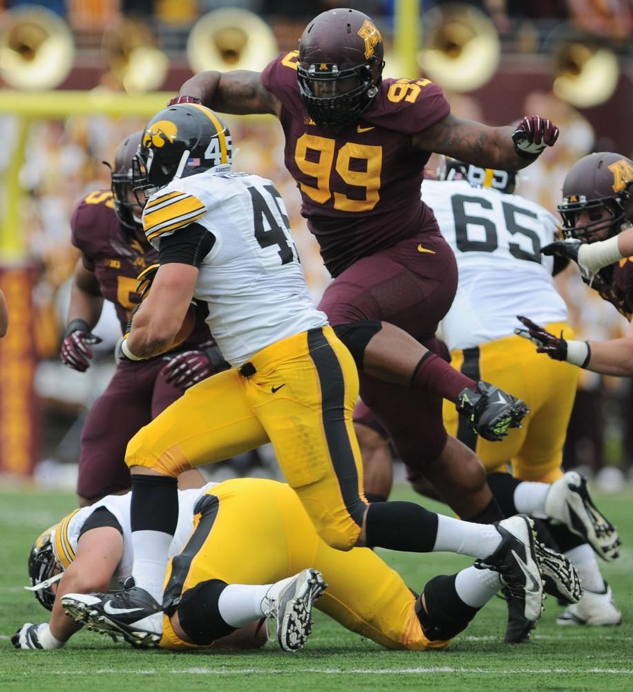 Minnesota defensive lineman RaShede Hageman moves to tackle an Iowa player Saturday, Sept. 28, 2013, at TCF Bank Stadium.