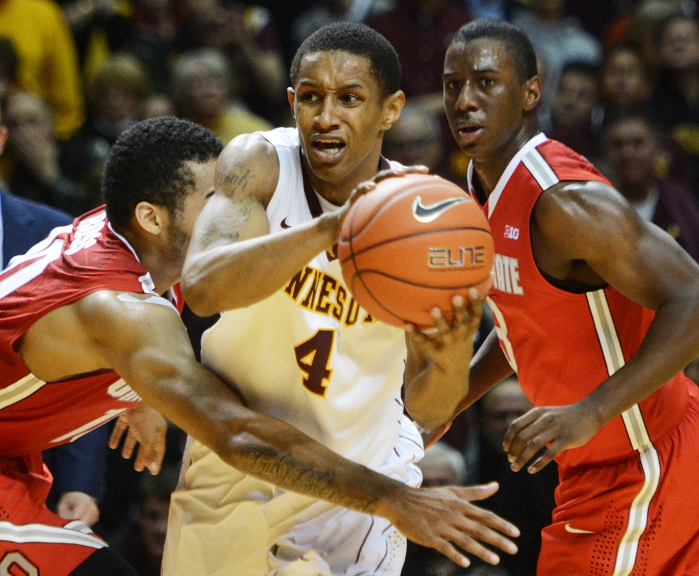 Minnesota guard Deandre Mathieu fights through Ohio State players at Williams Arena on Thursday. Mathieu led the team with 13 points.