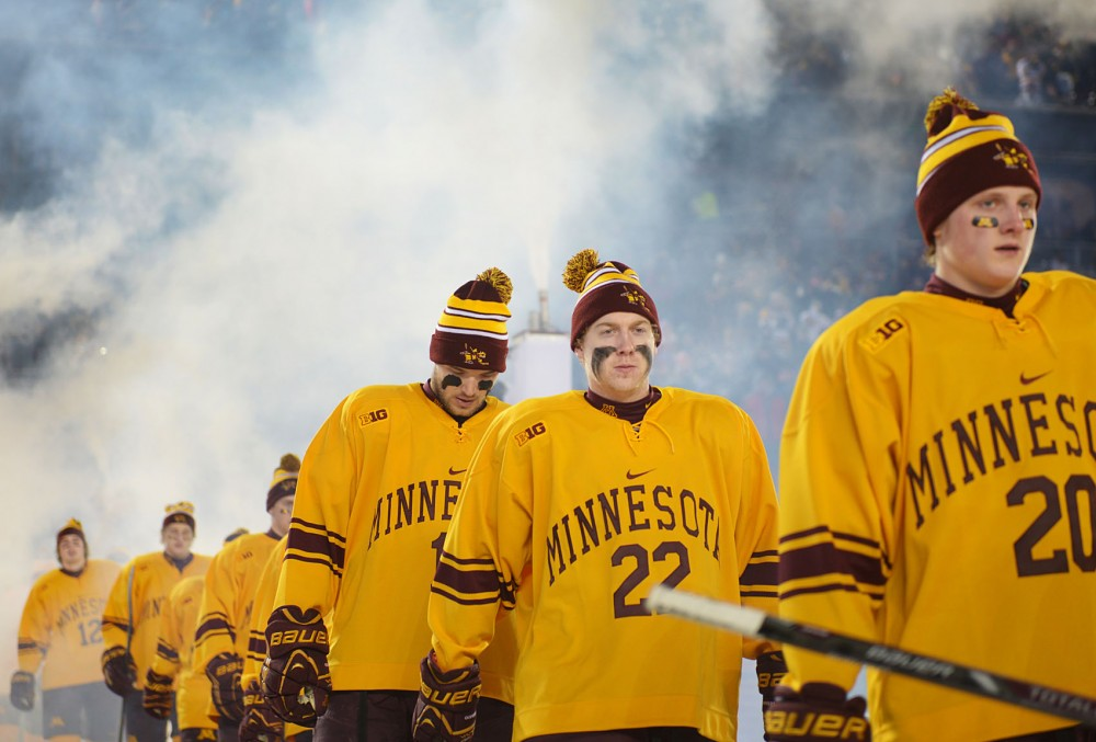 Minnesota men's hockey team walk out to the ice to start the 2014 Hockey City Classic game against the Buckeyes on Friday.
