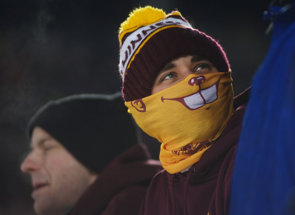 Gophers fan Ben Nierengarten wears his Gophers souvenir from the 2014 Hockey City Classic game at TCF Bank Stadium on Friday.