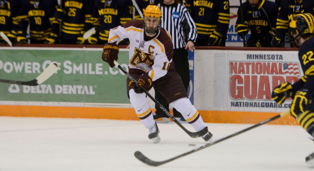 Minnesota forward Nate Condon controls the puck against Michigan at Mariucci on Friday. Gophers swept Michigan, winning 5-3 Friday and 4-1 Saturday.