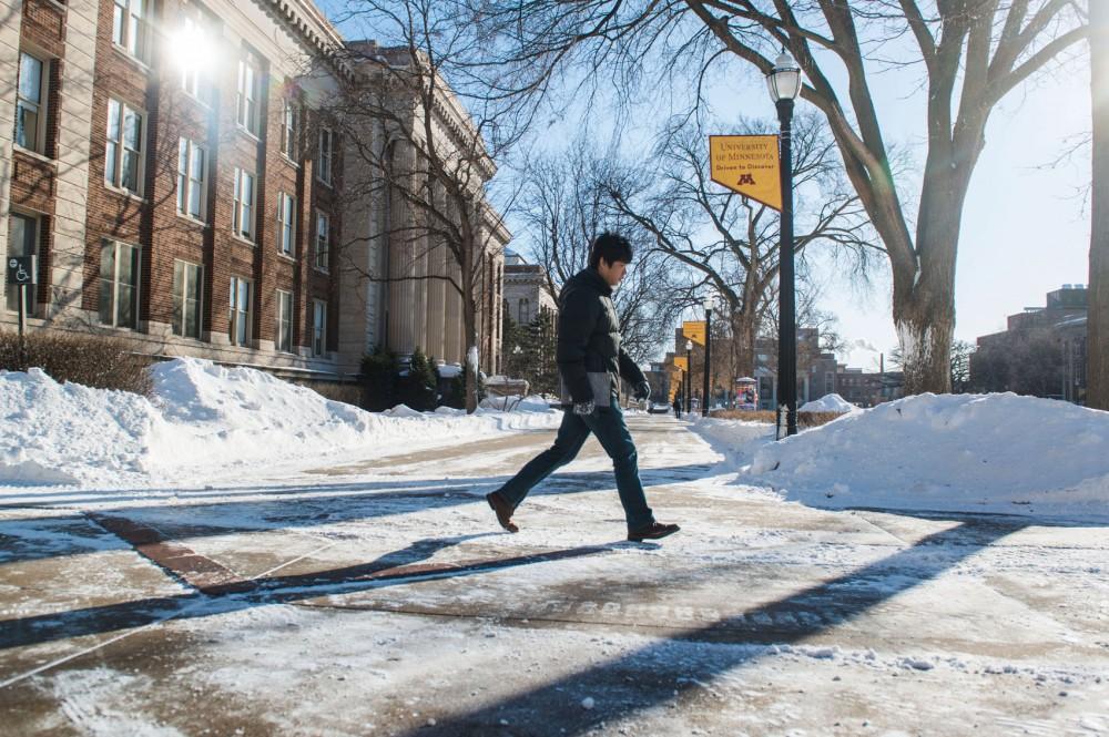 A lone student treks across the pedestrian mall in subzero temperatures while school was closed Jan. 27.