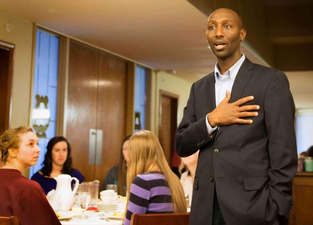Mohamud Noor, currently running for the position of State Representative in district 60B, addresses members of the Alpha Chi Omega sorority on Monday.